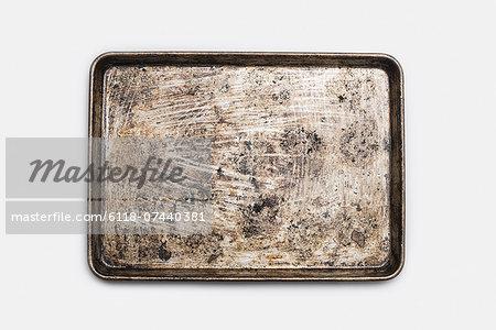 A well used, seasoned baking tray. Cookware. Baking sheet.