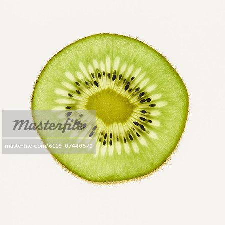 Organic kiwi slice, white background