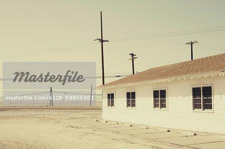 Abandoned building along rural, desert road, Trona, California