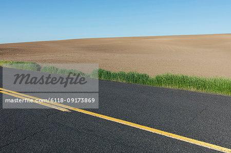 Road through fertile farmland in Spring