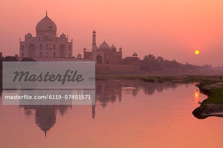 Taj Mahal reflected in the Yamuna River at sunset, UNESCO World Heritage Site, Agra, Uttar Pradesh, India, Asia