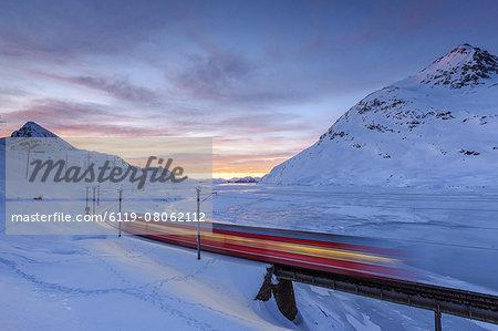 The Bernina Express red train, UNESCO World Heritage Site, Graubunden, Swiss Alps, Switzerland, Europe
