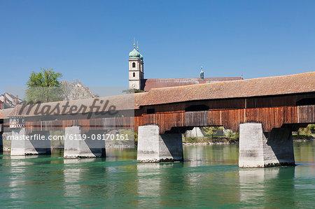 Historical wooden bridge and cathedral (Fridolinsmuenster), Bad Saeckingen, Rhine River, Hochrhein, Black Forest, Baden- Wurttemberg, Germany, Europe