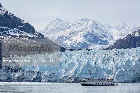 A tourist ship explores the Lamplugh Glacier in Glacier Bay National Park and Preserve, southeast Alaska, United States of America, North America