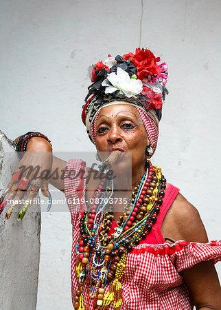 Woman smoking cigar, old Havana, Cuba, West Indies, Caribbean, Central America