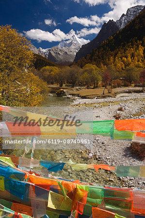 Prayer flags and Xiaruoduojio mountain, Yading Nature Reserve, Sichuan Province, China, Asia