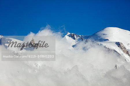 Mont Blanc, 4810m, and Aiguille du Midi cable car station, Chamonix, Haute Savoie, Rhone Alpes, French Alps, France, Europe