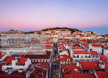 Miradouro de Santa Justa, view over downtown and Santa Justa Street towards the castle hill at sunset, Lisbon, Portugal, Europe