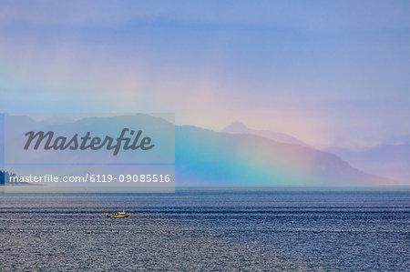 Boat, huge rainbow colours light up mist over the Fairweather Range, Icy Strait, near Glacier Bay, Inside Passage, Alaska, United States of America, North America