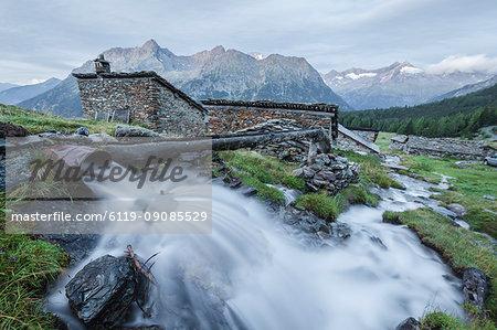 Flowing water of alpine creek, Entova Alp, Malenco Valley, Sondrio province, Valtellina, Lombardy, Italy, Europe