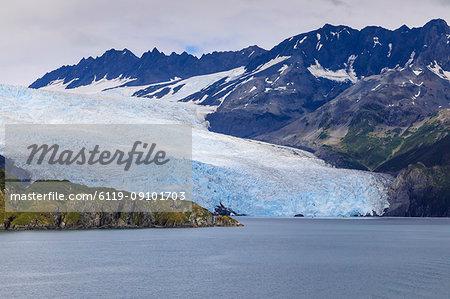 Aialik Glacier, mountains, island and blue ice, Harding Icefield, Kenai Fjords National Park, near Seward, Alaska, United States of America, North America