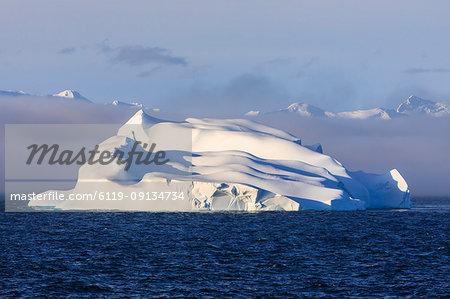 Huge iceberg, evening light, clearing mist, Bransfield Strait, near South Shetland Islands and Antarctic Peninsula, Antarctica, Polar Regions