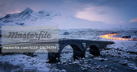 Sligachan Bridge in the snow with car light trails, Isle of Skye, Inner Hebrides, Scotland, United Kingdom, Europe