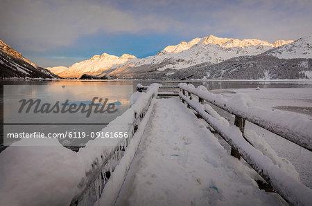 Walkway covered with snow, Lake Sils, Plaun da Lej, Maloja Region, Canton of Graubunden, Engadine, Switzerland, Europe