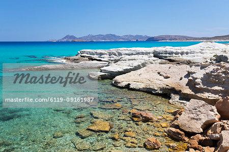 Clear turquoise sea and volcanic rock formations at Sarakiniko, Sarakiniko, Milos, Cyclades, Aegean Sea, Greek Islands, Greece, Europe
