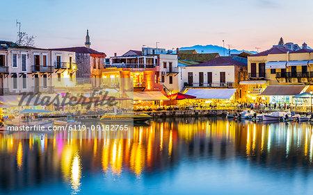 Old Venetian harbour, taverns on seaside at dusk, Rethymno (Rethymnon), Crete, Greek Islands, Greece, Europe