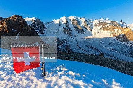 Swiss flag with Palu and Vedret Pers Glacier, Diavolezza Refuge, Bernina Pass, Engadine, Graubunden, Switzerland, Europe