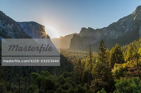 Morning view of sun peaking round El Capitan, Yosemite National Park, UNESCO World Heritage Site, California, United States of America, North America