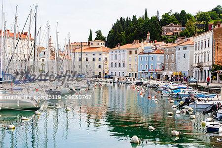 Historic harbor with boats, Piran, Slovenia, Europe