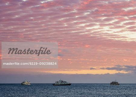 Cruise ships off Bartolome Island at sunrise, Galapagos, UNESCO World Heritage Site, Ecuador, South America