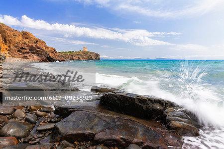 Wave breaks on the rocks. Cannai Tower(Torre Cannai), Sant'Antioco Island, Sud Sardegna province, Sardinia, Italy, Mediterranean, Europe