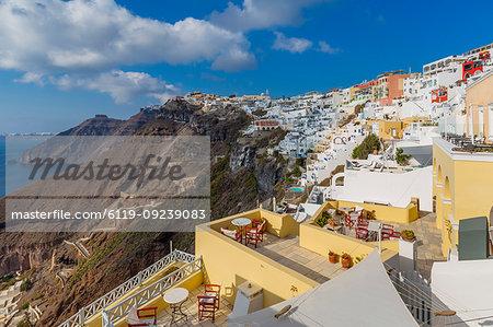 View of Fira white washed houses clinging to rocks, Firostefani, Santorini (Thira), Cyclades Islands, Greek Islands, Greece, Europe