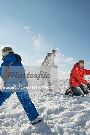 Family having snowball fight, Bavaria, Germany