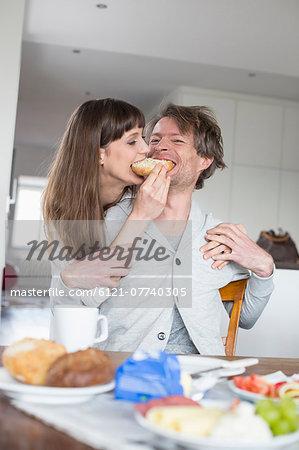 Couple sharing breakfast,