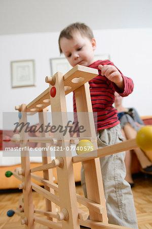Boy playing skill game