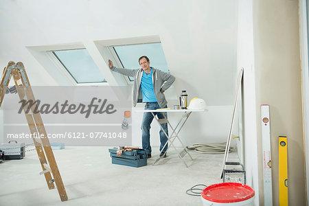Portrait of man renovating