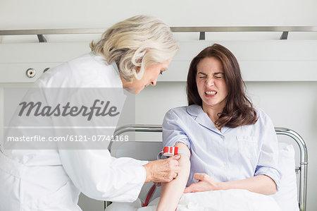 Doctor preparing infusion needle