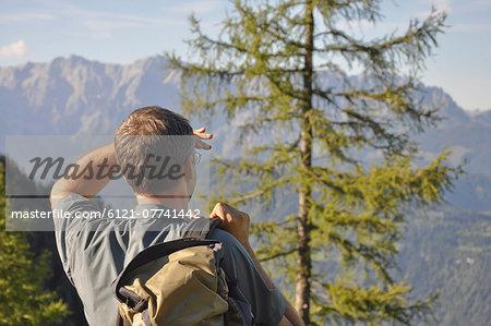 Hiker looking at mountains, Salzburger Land, Austria