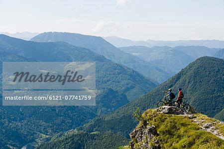 two mountain bikers looking at view, Slatnik, Istria, Slovenia