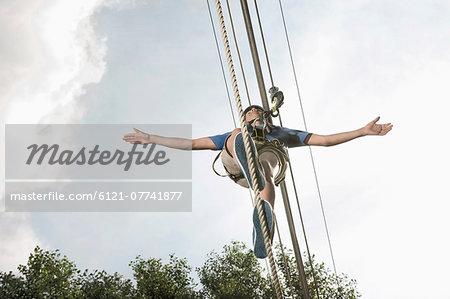 teenager balancing in a climbing crag