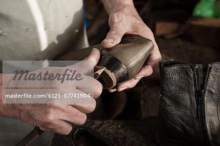 Cobbler working in workshop, close-up