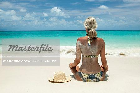 woman sitting on the beach, Koh Lipe, Thailand