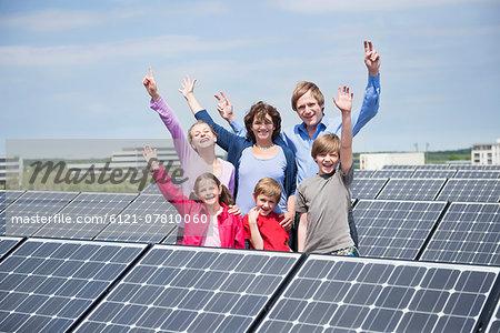 Large family four kids solar energy park happy