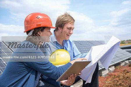 Meeting architect man woman blueprint solar energy