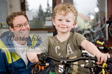 Boy getting a new children's bike