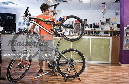 Young man buying bicycle, Bavaria, Germany