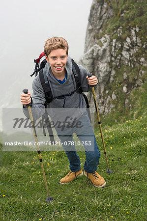 Teenage boy hiking in mountains Alps