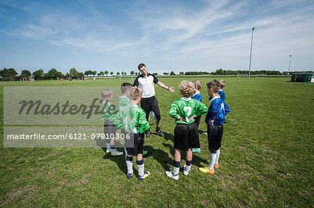 Soccer trainer junior football team practice