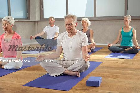Yoga class senior group meditation relaxing