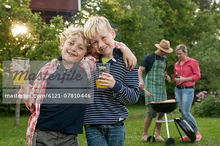 Family barbecue parents boys friends garden