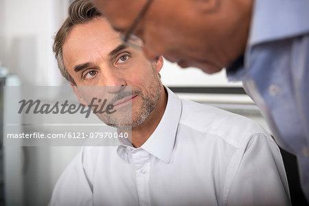 Meeting two businessmen Afrikaner European office