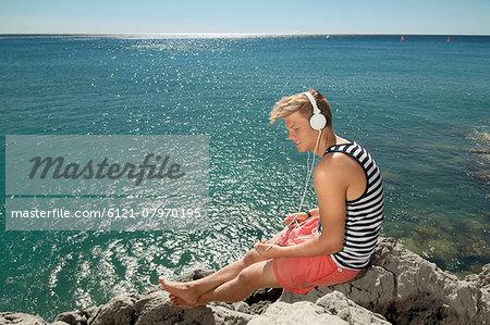 Teenager boy relaxing headphones listening music