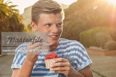 Teenager sunset eating ice cream summer