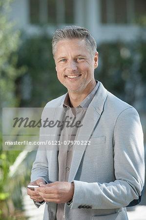 Businessman suit portrait smiling telephoning