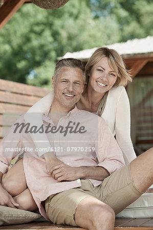Portrait couple hugging smiling summerhouse
