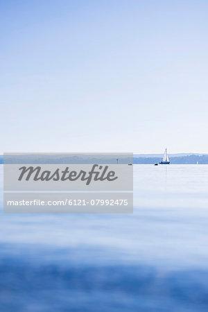 Yacht horizon sunrise mist distant seascape